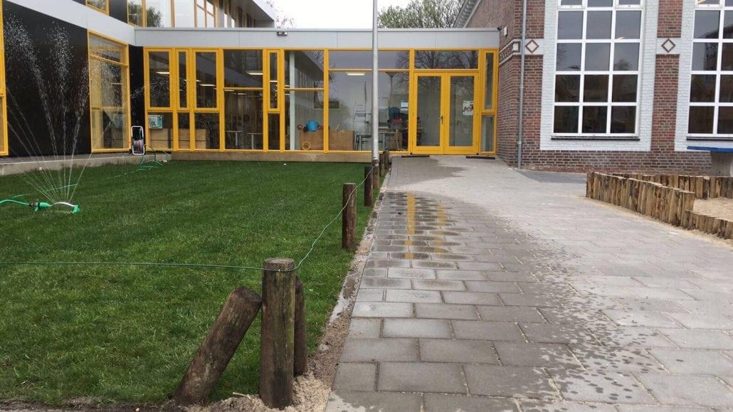 Gras aanleggen schoolplein